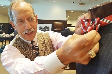 Robert Rosenthal adjusts a display tie at Brooks Brothers Biltmore Fashion Park store. (Photo by Josh Coddington/GPCC)