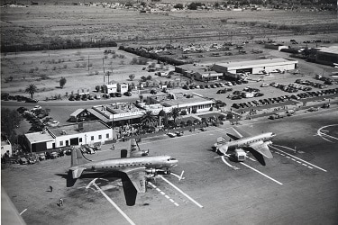 The north terminal is pictured in 1948 with an American Airlines DC-4 and another plane parked out front. (Photo courtesy of Sky Harbor International Airport).